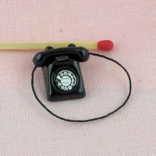 Téléphone miniature antique maison poupée 2 cm.