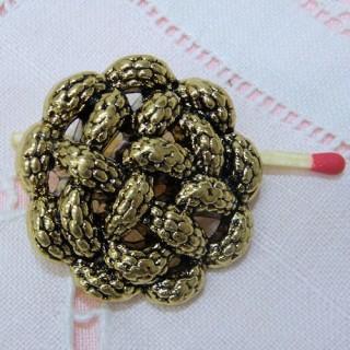 Bouton haute couture doré àpied motif corde 3 tailles.