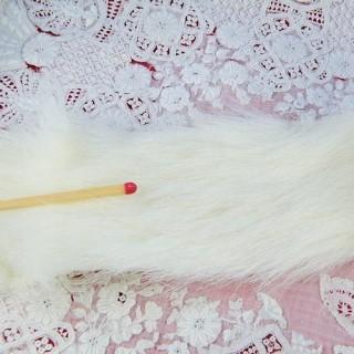 Fourrure synthétique en ruban col poupée par 10 cm.