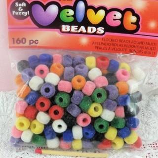 Sac petites Perles en velours multicolores 9 mm.