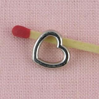 Breloque coeur évidé 15 mm.