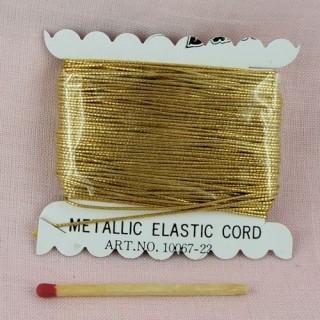 Fil élastique rond or 1 mm.