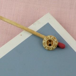 Bouton mercerie gravé  fleur 1 cm.