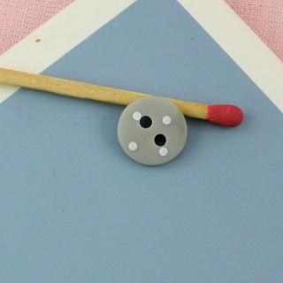 Bouton mercerie impriméois 1 cm.