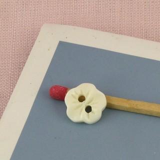 Boutons forme fleur sculpté 1 cm.