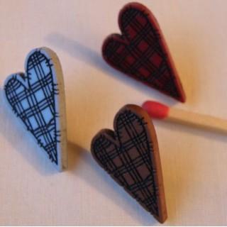 Botón corazón escocés a pie forma estida