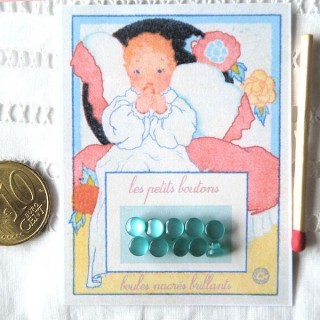 Vintage card of tiny shank buttons.