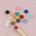 Boutons minuscules 2 trous 4 mm.