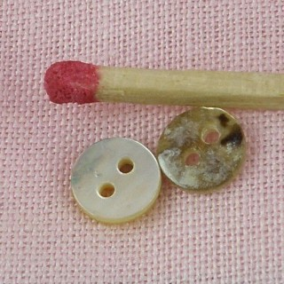Button,Mother of pearl 2 holes rustic 6 mms.