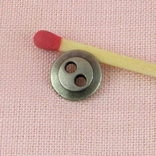 Metallic button, two holes, 9mm