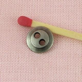 Metallic button, two holes, 9mm