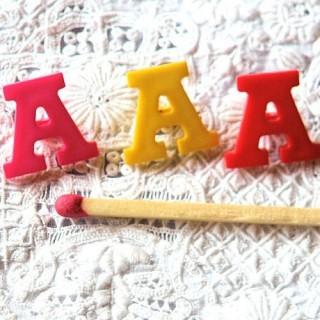 Bouton lettre alphabet A àpied, 1 cm