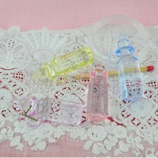 Baby doll bottles colored plastic 3 cms