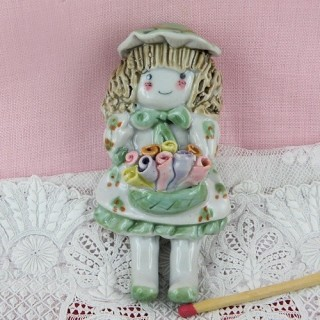 Little girl with flowers decoration 10 cm.