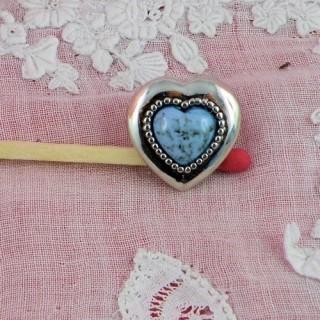 Botones a pie corazón esculpidos 15 mms.