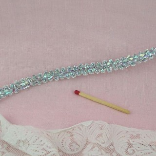 Silver holographic braid, 1,25 cms.