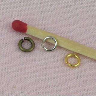 Perles rondes bronze, sertissage 2,5mm.