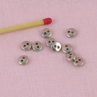 Boutons creux  2 trous,, nacrés à bord 4,8 mm.