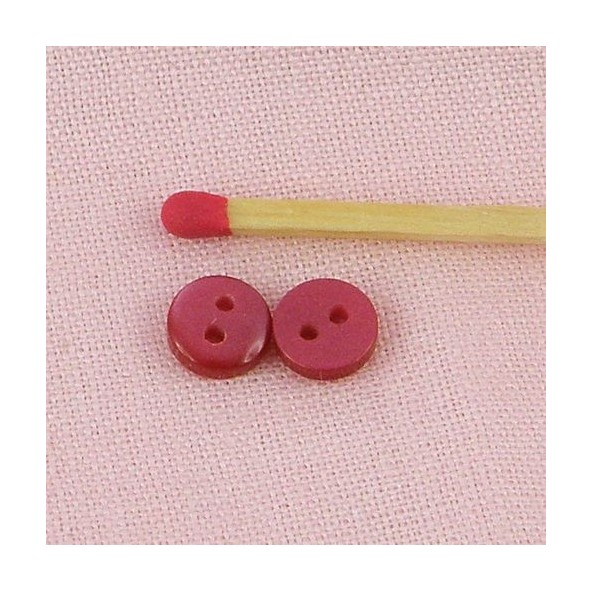 Flat convex, hollow translucent simple buttons 7 mms.