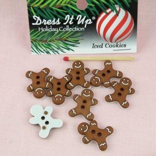 Pasteles de galletas Navidad vestido encima del botón