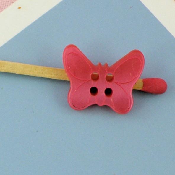 Bouton nacré papillon noeud 2 cm.