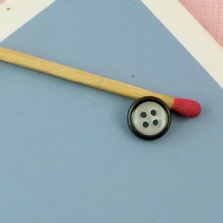 Bouton nacre cerclé métal argenté
