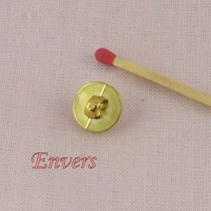 Botón plástico rueda perla  1 cm.