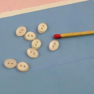 Botones ovales rosados y blancos 7 x 9 mm.