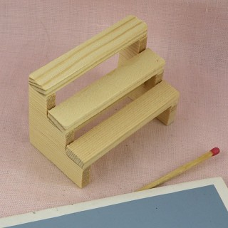 Mini wood 3-step shelf made in raw wood.