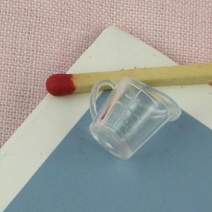 Pequeña medida miniatura en plástico graduado
