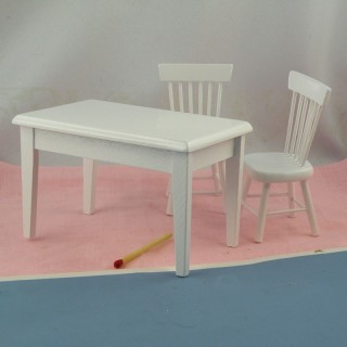 Table and chairs furnish miniature doll's house