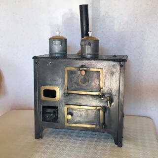 Wood-burning stove dollhouse kitchen.