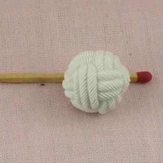 Bouton plastique boule perle tressée 1 cm.