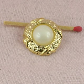 Botón plástico rueda perla  2 cm.