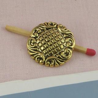 Bouton doré à motifs gravés àpied 25 mm