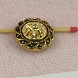 Bouton doré à motifs gravés àpied 24 mm