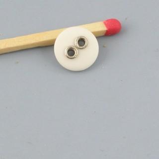 Bouton mercerie trous métal 9 mm.