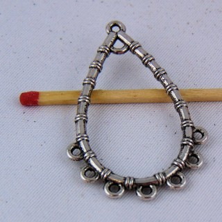 Charm pendentive forms drop out of openwork metal 4 cm