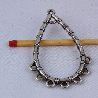 Dije colgante forma gota en metal agujereado 36 mm