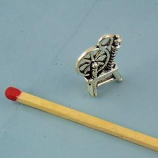 Breloque rouet miniature en métal 1 cm