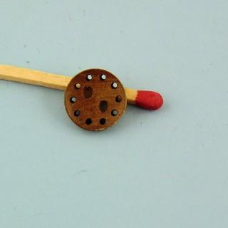 Bouton bois surpiqué 2 trous 1 cm.