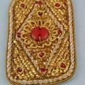 Ecusson ethnique brodé or badge 8 cm.