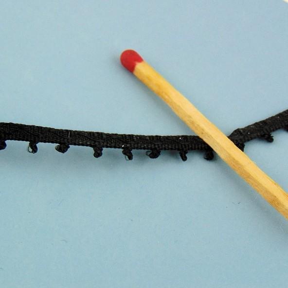 Ribete galón a lengüetas borla 5 mm.