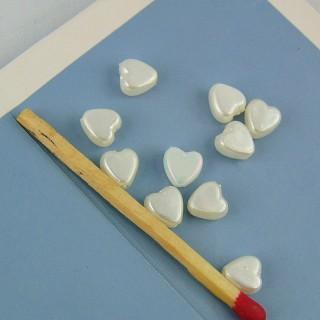 10 Perles coeurs plastique 6 mm.