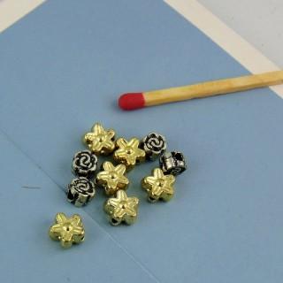 10 Perles fleurs couleur métal plastique 6 mm.