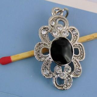 Diamante de imitación y colgante de metal hematita