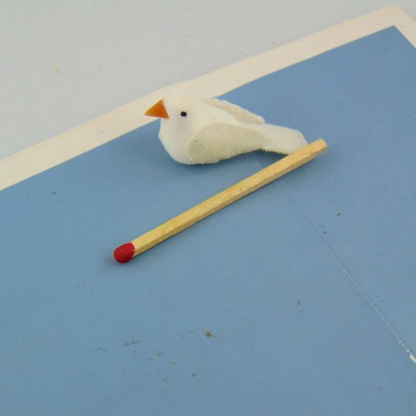 Miniature white plastic dove