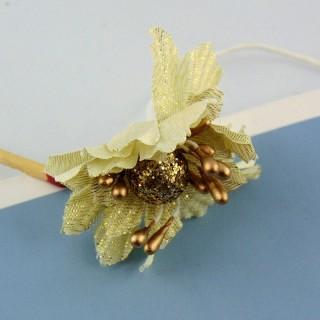 Fleur en tissu doré tige métal