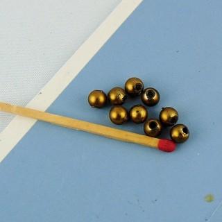 10 perlas redondas doradas de 4 mm.