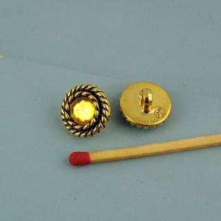 Botón de pedrería amarillo en el pie 13 mm.